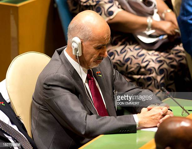 Libya President Mohamed Yousef ElMagariaf listens the speech of US President Obama at the 67th United Nations General Assembly meeting September 25...