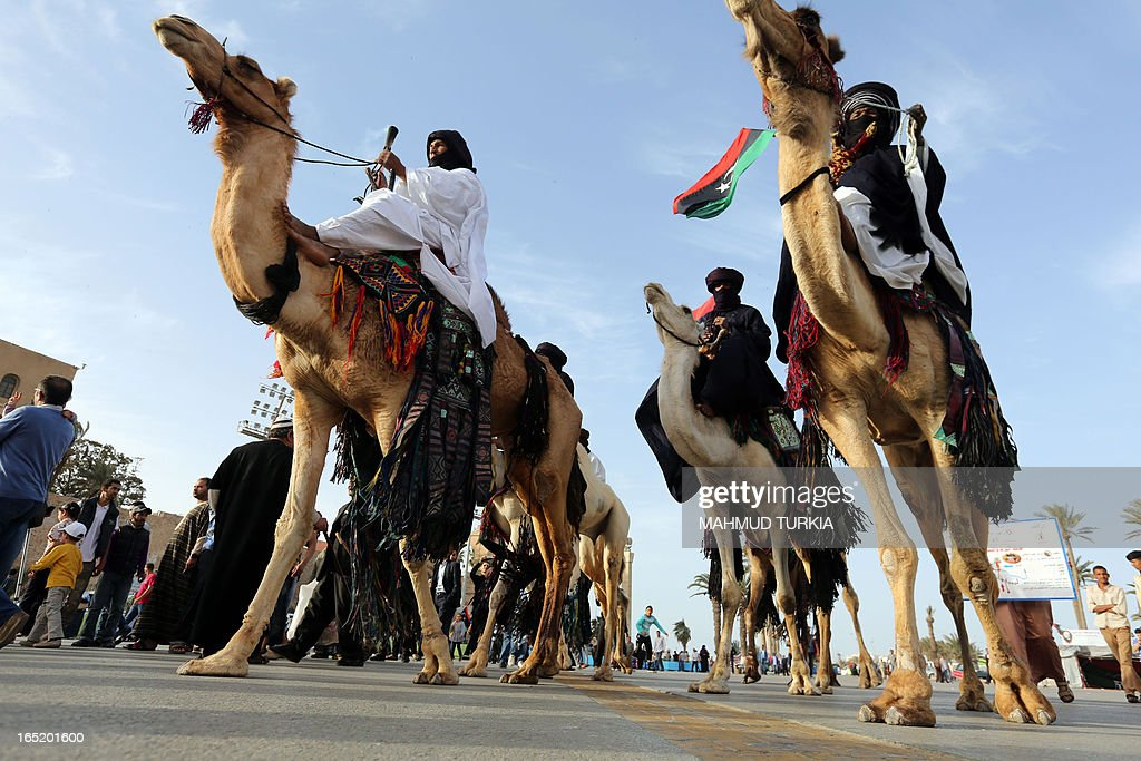 Libyan camel and Horse riders arrive in Tripoli's landmark Maryrs square to welcom the flame of Freedom and Development after it travelled from Benghazi, Sabah and Zuwahara marking the opening of the second Libyan International Fair on April 1, 2013 in Tripoli, Libya. Gunmen posing as security personnel kidnapped a top aide of Libyan Prime Minister Ali Zeidan, just hours after the premier revealed members of his government had received death threats, a cabinet source told AFP on Monday.