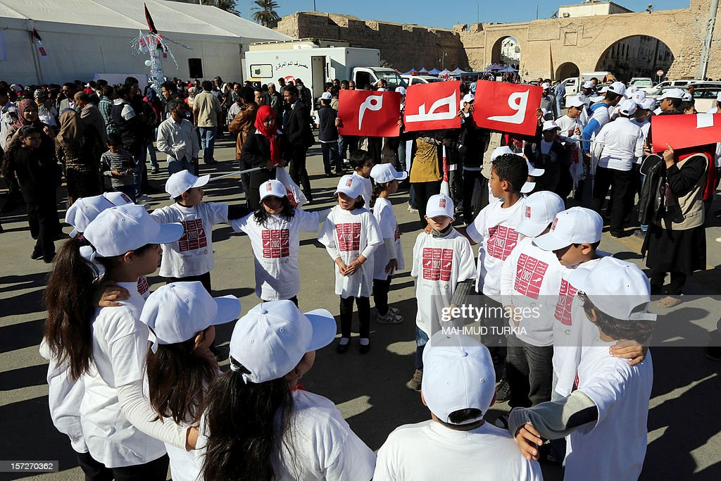 Libyan children take part to an event marking the World AIDS Day in Tripoli, on December 1, 2012. The World AIDS Day marks a pandemic that in 2011 claimed 1.7 million lives and led to 2.5 million new HIV infections, according to the latest UN figures.