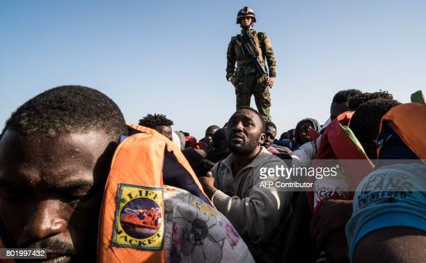 A Libyan coast guardsman stands on a boat during the rescue of 147 illegal immigrants attempting to reach Europe off the coastal town of Zawiyah 45...