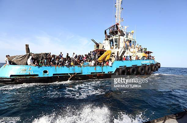 A Libyan coastguard boat carrying mostly African migrants arrive at the port in the city of Misrata on May 3 after the coastguard intercepted five...