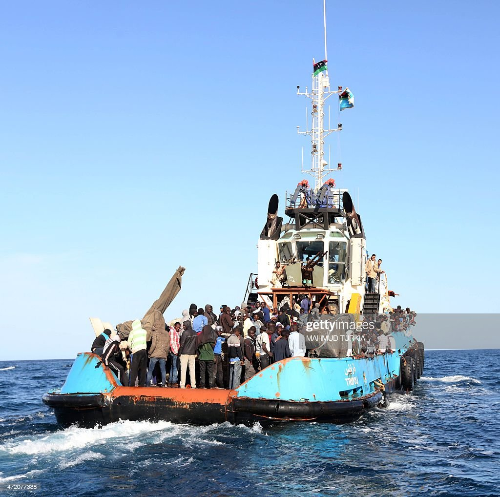 A Libyan coastguard boat carrying mostly African migrants prepares to dock at the port in the city of Misrata on May 3 after the coastguard...