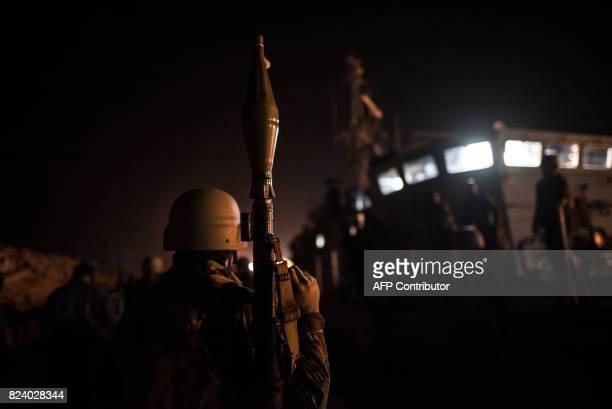 A Libyan coastguard holds a rocketpropelled grenade as he patrols the area at sea between Sabratha and Zawiyah on July 28 2017 / AFP PHOTO / TAHA...