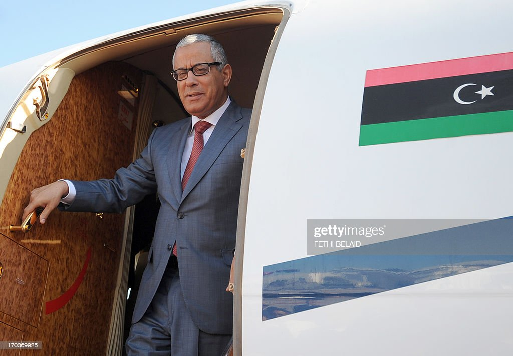 Libyan counterpart <a gi-track='captionPersonalityLinkClicked' href=/galleries/search?phrase=Ali+Zeidan&family=editorial&specificpeople=7544817 ng-click='$event.stopPropagation()'>Ali Zeidan</a> arrives at Tunis-Carthage airport on June 12, 2013, in Tunis. Zaydan is on two days official visit to Tunisia. AFP PHOTO/FETHI BELAID