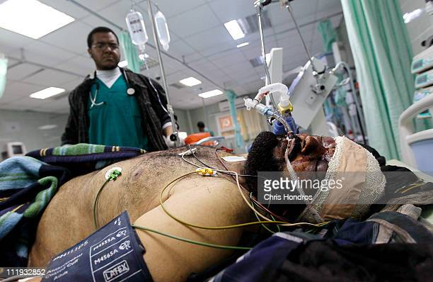 Libyan doctor in Ajdabiyah Hospital looks over a civilian man shot in the head during clashes April 9 2011 in Ajdabiyah Libya Rebels continued their...