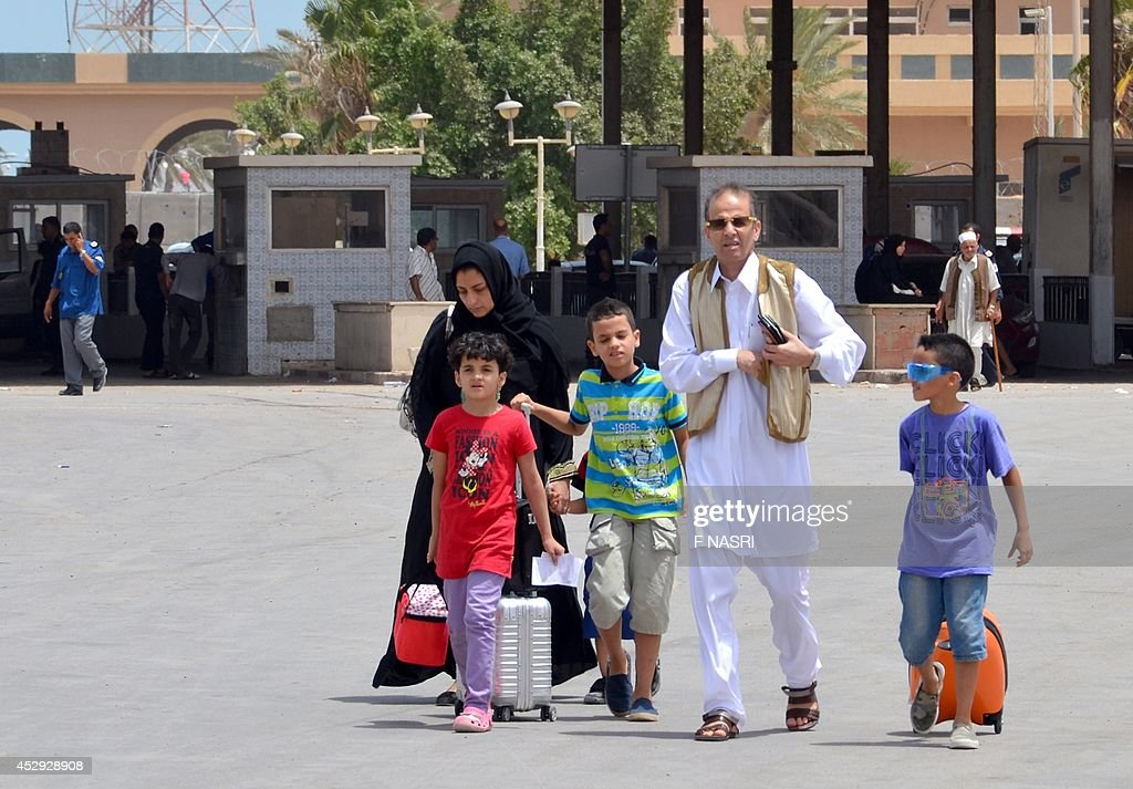 A Libyan family fleeing the violence in its country enters Tunisia through the southern border crossing at Ras Jedir on July 30, 2014. Tunisia cannot cope with any massive influx of refugees who might seek to enter the country from strife-torn neighbouring Libya and will close its border if necessary, the foreign minister said.