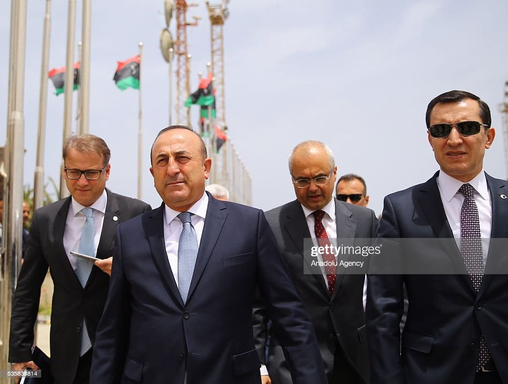Libyan Foreign Minister Mohamed Siala (R) welcomes Turkish Foreign Minister Mevlut Cavusoglu (L) upon his arrival in Tripoli, Libya on May 30, 2016.