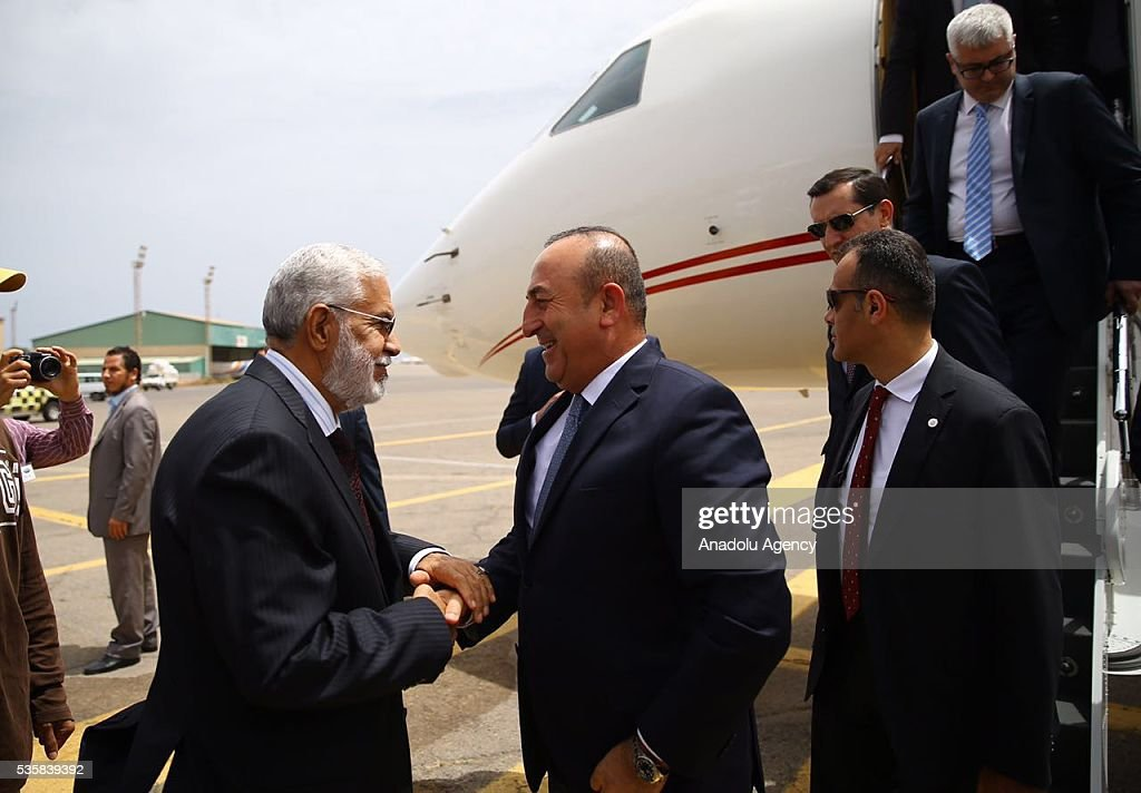 Libyan Foreign Minister Mohamed Siala (L) welcomes Turkish Foreign Minister Mevlut Cavusoglu (R) upon his arrival in Tripoli, Libya on May 30, 2016.