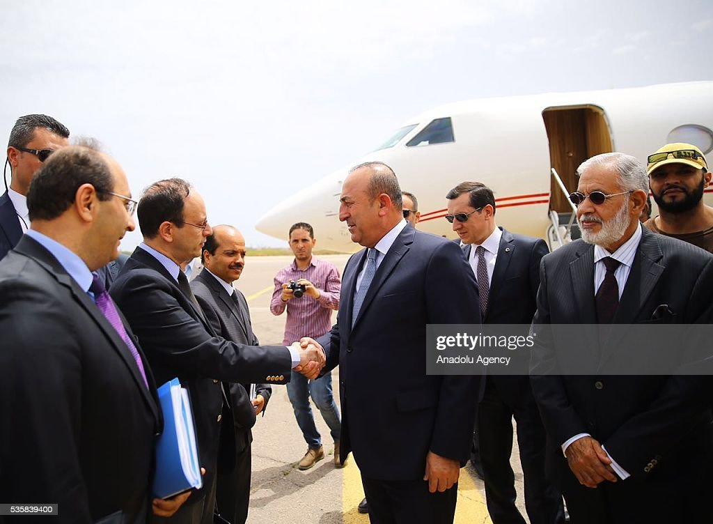 Libyan Foreign Minister Mohamed Siala (C) welcomes Turkish Foreign Minister Mevlut Cavusoglu (R) upon his arrival in Tripoli, Libya on May 30, 2016.
