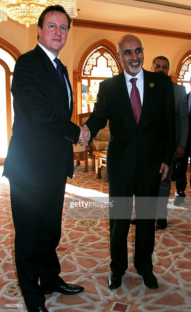 Libyan General National Congress president Mohammed Megaryef (R) greets British Prime Minister David Cameron (L) ahead of their meeting on January 31, 2013 in the Libyan capital, Tripoli. Cameron made a surprise visit to Tripoli for talks centred on security, just days after his government, which played a key role in Libya's revolution, warned of threats to its embassy.