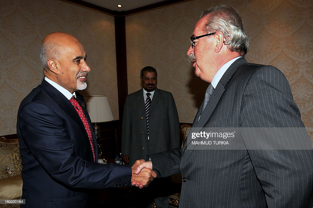 Libyan General National Congress president Mohammed Megaryef (L) shakes hands with Oil giant Total Chief Executive Officer Christophe de Margerie (R) during their meeting at the Presidential guest house on January 29, 2013 in Tripoli. TURKIA