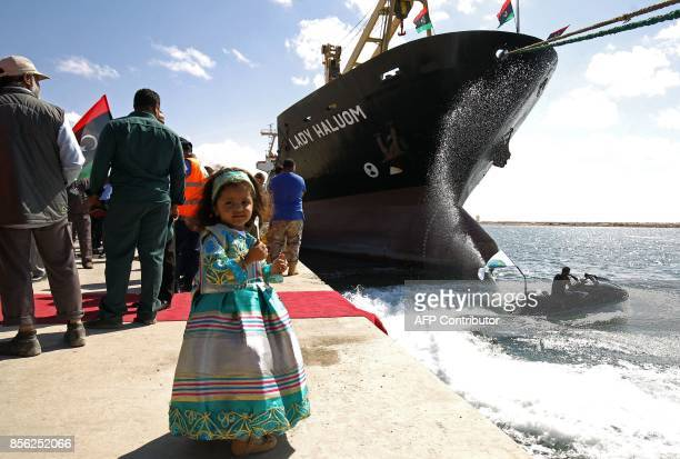 A Libyan girl poses for a photo at the Benghazi port which was closed for the past three years due to rebel groups occupying the eastern Libyan city...