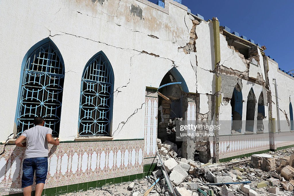 A Libyan inspects the damage at a Sufi shrine in the neighbourhood of Tajoura, on the outskirts of Tripoli, after is was attacked during the early hours of the morning by unknown individuals on March 28, 2013. Unknown attackers planted and set off an explosive device, partially destroying the mausoleum of Sidi Mohamed Landoulsi, a 15th Century Sufi Theologist.