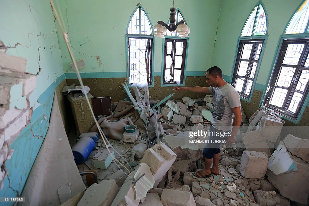 A Libyan inspects the damage inside Sufi shrine in the neighbourhood of Tajoura, on the outskirts of Tripoli, after is was attacked during the early hours of the morning by unknown individuals on March 28, 2013. Unknown attackers planted and set off an explosive device, partially destroying the mausoleum of Sidi Mohamed Landoulsi, a 15th Century Sufi Theologist. AFP PHOTO/MAHMUD TURKIA