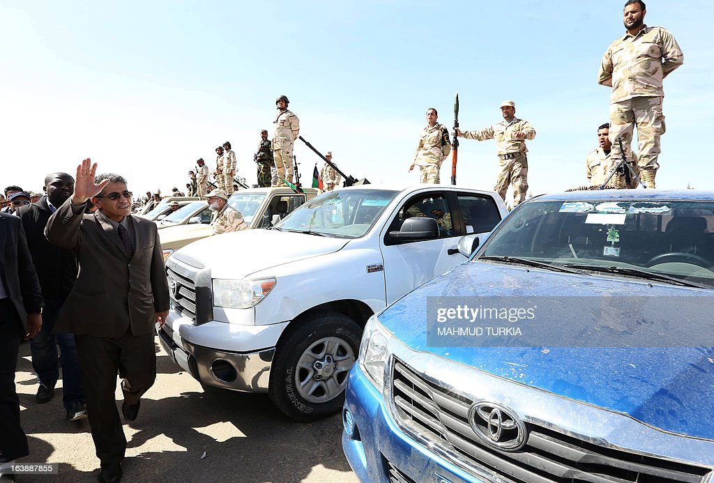 Libyan Interior Minister Ashour Shuail (C) and Libyan Army Chief of Staff Yusef Mangush (unseen), visit security forces as the government announces the start of a campaign to dislodge armed groups illegally occupying more than 500 privately owned or state-owned buildings on March 17, 2013, in the capital Tripoli. The campaign will also include properties outside of the capital. AFP PHOTO/MAHMUD TURKIA