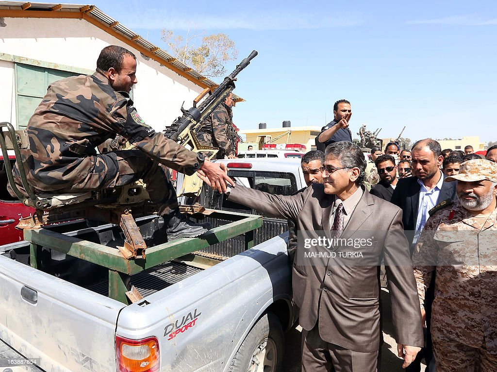 Libyan Interior Minister Ashour Shuail visit security forces as the government announces the start of a campaign to dislodge armed groups illegally occupying more than 500 privately owned or state-owned buildings on March 17, 2013, in the capital Tripoli. The campaign will also include properties outside of the capital.