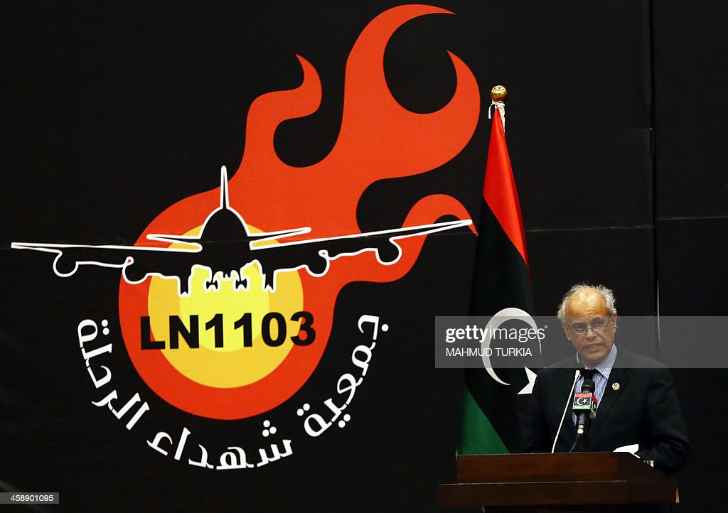 Libyan Justice Minister Salah el-Merghani speaks during a memorial service in Tripoli, on December 22, 2013, to commemorate the 157 people who were killed in a Libyan Arab Airlines plane crash on December 22, 1992 near Tripoli's international airport.