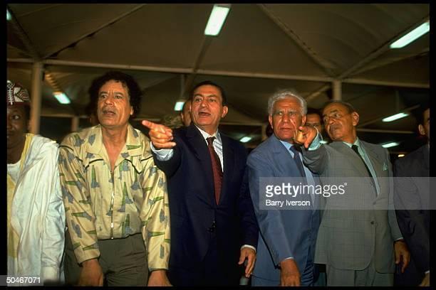 Libyan ldr Gaddafy showing off manmade river project to Chadli Bendjedid Hassan Mubarak inaugurating Salluq Reservoir