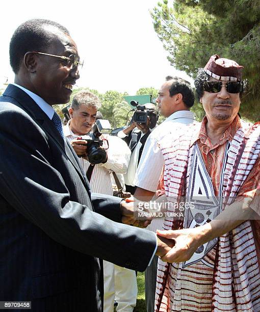 Libyan leader Moamer Kadhafi greets Chadian President Idriss Deby upon his arrival for a meeting in Tripoli on August 8 2009 Deby is on an official...