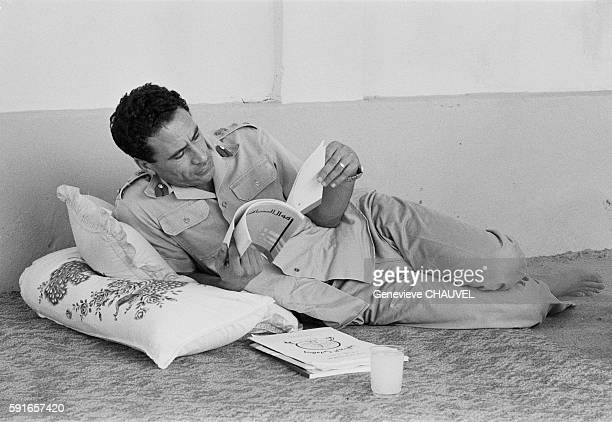 Libyan Leader Muammar alQaddafi reading in his home in Tripoli Libya