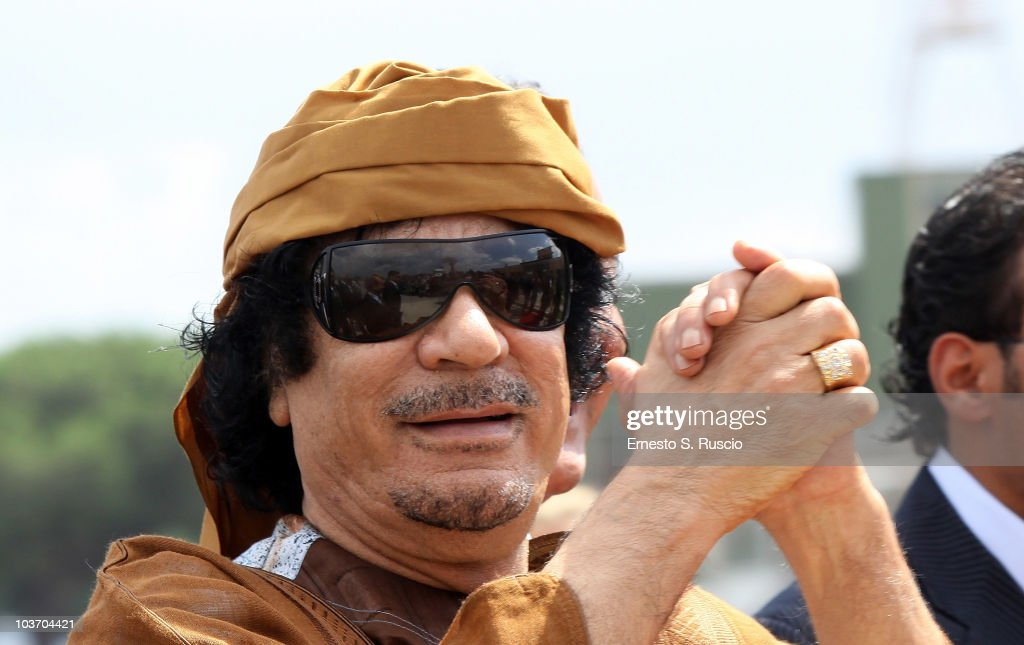 Libyan leader <a gi-track='captionPersonalityLinkClicked' href=/galleries/search?phrase=Muammar+Gaddafi&family=editorial&specificpeople=202172 ng-click='$event.stopPropagation()'>Muammar Gaddafi</a> arrives at Ciampino airport on August 29, 2010 in Rome, Italy. Gadaffi is on an official two-day visit to Italy for talks with Prime Minister Silvio Berlusconi. The visit also marks the second anniversary of a friendship treaty between Italy and Lybia.