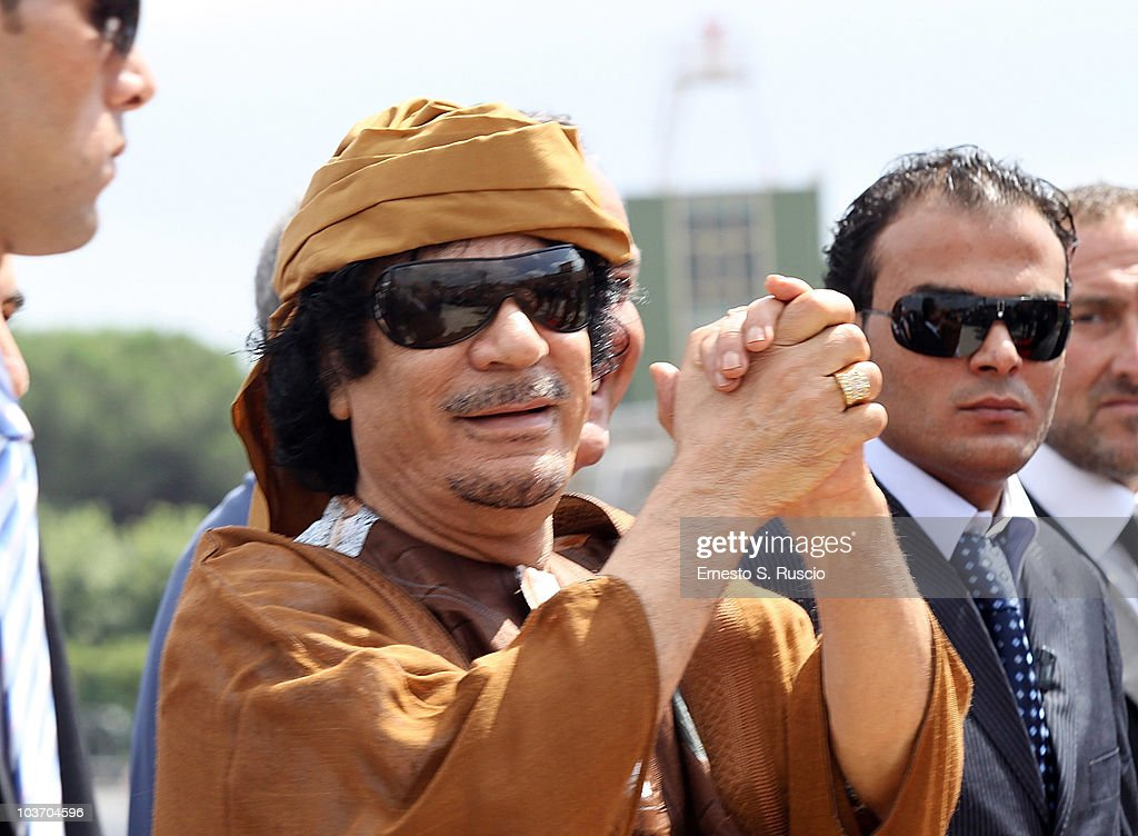 Libyan leader <a gi-track='captionPersonalityLinkClicked' href=/galleries/search?phrase=Muammar+Gaddafi&family=editorial&specificpeople=202172 ng-click='$event.stopPropagation()'>Muammar Gaddafi</a> arrives at the Ciampino airport on August 29, 2010 in Rome, Italy. Gadaffi is on an official two-day visit to Italy for talks with Prime Minister Silvio Berlusconi. The visit also marks the second anniversary of a friendship treaty between Italy and Lybia.