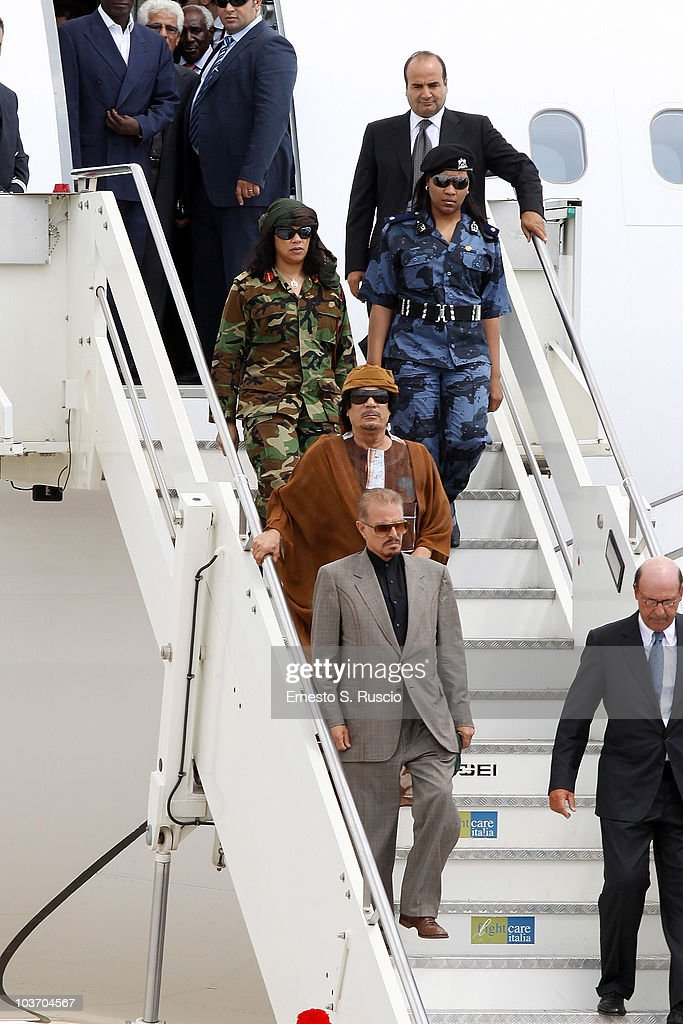 Libyan leader Muammar Gaddafi, escorted by female bodyguards, arrives at the Ciampino airport on August 29, 2010 in Rome, Italy. Gadaffi is on an official two-day visit to Italy for talks with Prime Minister Silvio Berlusconi. The visit also marks the second anniversary of a friendship treaty between Italy and Lybia.