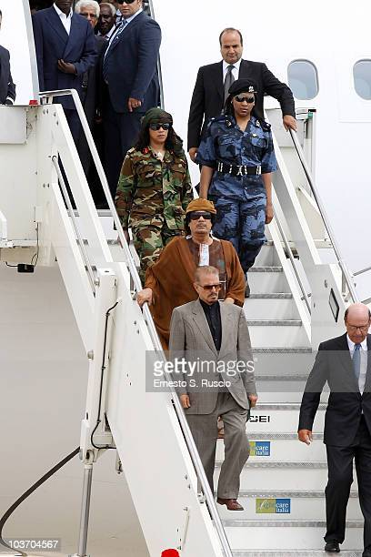 Libyan leader Muammar Gaddafi escorted by female bodyguards arrives at the Ciampino airport on August 29 2010 in Rome Italy Gadaffi is on an official...
