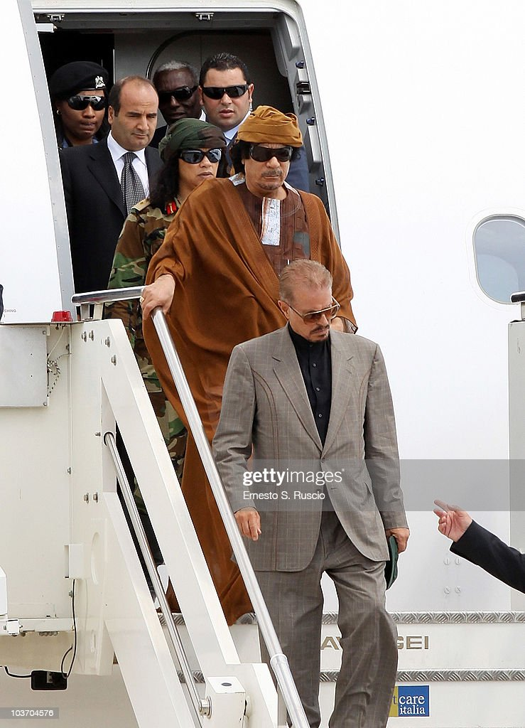 Libyan leader <a gi-track='captionPersonalityLinkClicked' href=/galleries/search?phrase=Muammar+Gaddafi&family=editorial&specificpeople=202172 ng-click='$event.stopPropagation()'>Muammar Gaddafi</a>, escorted by female bodyguards, arrives at the Ciampino airport on August 29, 2010 in Rome, Italy. Gadaffi is on an official two-day visit to Italy for talks with Prime Minister Silvio Berlusconi. The visit also marks the second anniversary of a friendship treaty between Italy and Lybia.