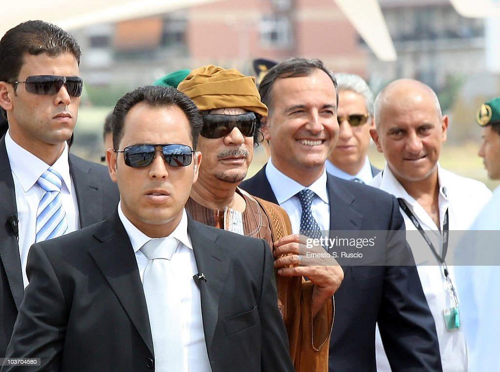 Libyan leader <a gi-track='captionPersonalityLinkClicked' href=/galleries/search?phrase=Muammar+Gaddafi&family=editorial&specificpeople=202172 ng-click='$event.stopPropagation()'>Muammar Gaddafi</a> is greeted by Italian Minister of Foreign Affairs <a gi-track='captionPersonalityLinkClicked' href=/galleries/search?phrase=Franco+Frattini&family=editorial&specificpeople=536993 ng-click='$event.stopPropagation()'>Franco Frattini</a> at the Ciampino airport on August 29, 2010 in Rome, Italy. Gadaffi is on an official two-day visit to Italy for talks with Prime Minister Silvio Berlusconi. The visit also marks the second anniversary of a friendship treaty between Italy and Lybia.