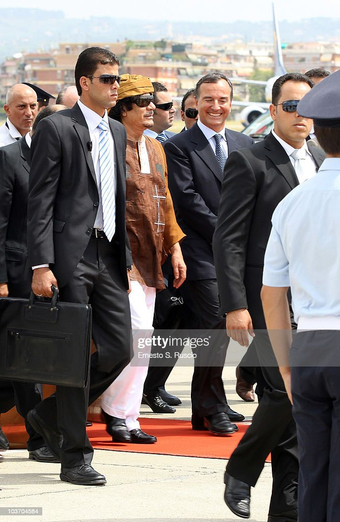 Libyan leader Muammar Gaddafi is greeted by Italian Minister of Foreign Affairs Franco Frattini at the Ciampino airport on August 29, 2010 in Rome, Italy. Gadaffi is on an official two-day visit to Italy for talks with Prime Minister Silvio Berlusconi. The visit also marks the second anniversary of a friendship treaty between Italy and Lybia.