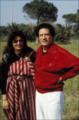 Libyan leader Muammar Gaddafi poses with wife Safia in the military barracks of Bab alAzizia on March 18 1992 in Tripoli Libya