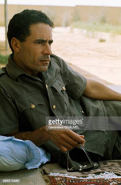Libyan leader Muammar Qaddafi relaxes at a fortified house in the Syrtes Desert Libya