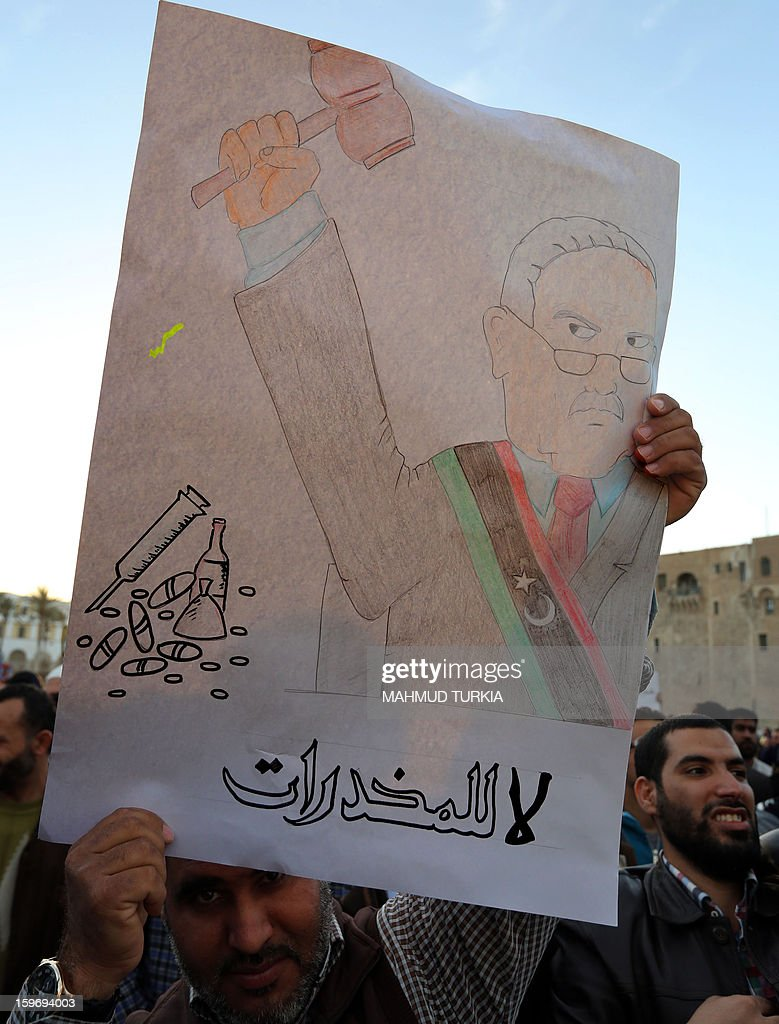 A Libyan man holds up a placard reading in Arabic, 'no to drugs' during a demonstration against drugs in Martyrs' Square in the Libyan capital Tripoli on January 18, 2013. AFP PHOTO/MAHMUD TURKIA