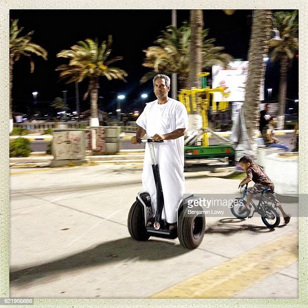 Libyan man rides on his Segway during a public Iftar celebration in Martyr's Square on July 22 2012 in Tripoli Libya The fall of Gaddafi opened up...