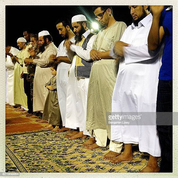 Libyan men pray during a public Iftar celebration in Martyr's Square on July 22 2012 in Tripoli Libya Conservative muslim values are an intrinsic...