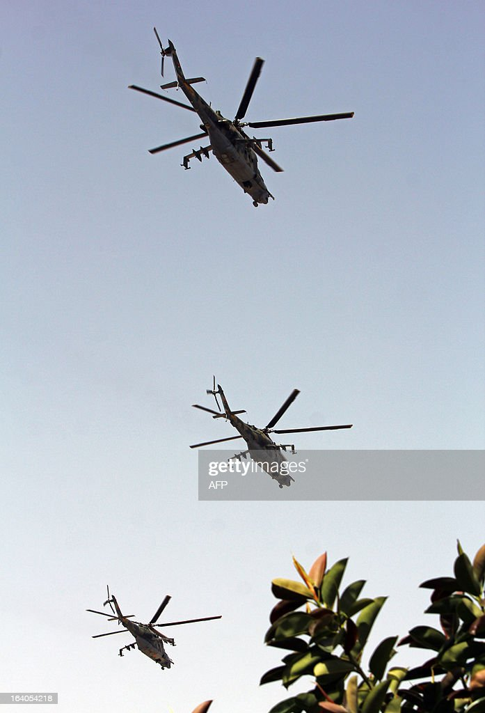 Libyan military helicopters fly over the eastern city of Benghazi during a parade to celebrate the second anniversary of Nato's first military operation in Libya on March 19, 2013. On 19 March 2011, Kadhafi's troops and tanks entered the city and the same day French forces began an international military intervention in Libya, later joined by coalition forces with strikes against armoured units south of Benghazi and attacks on Libyan air-defence systems, after UN Security Council Resolution 1973 called for using 'all necessary means' to protect Libyan civilians and populated areas from attack by government forces.