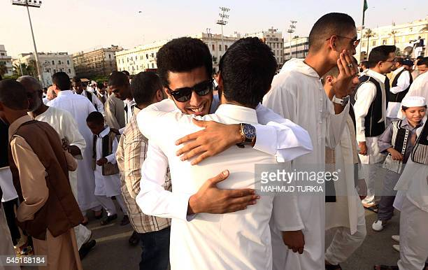 Libyan Muslim worshippers gather on Martyrs' Square in the capital Tripoli to perform Eid alFitr prayers on July 6 2016 Muslims worldwide celebrate...