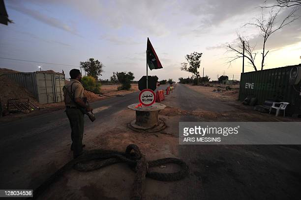 Libyan National Transitional Council fighter mans a checkpoint leading to Tawarga on September 25 2011 The people of Tawarga who are mostly...