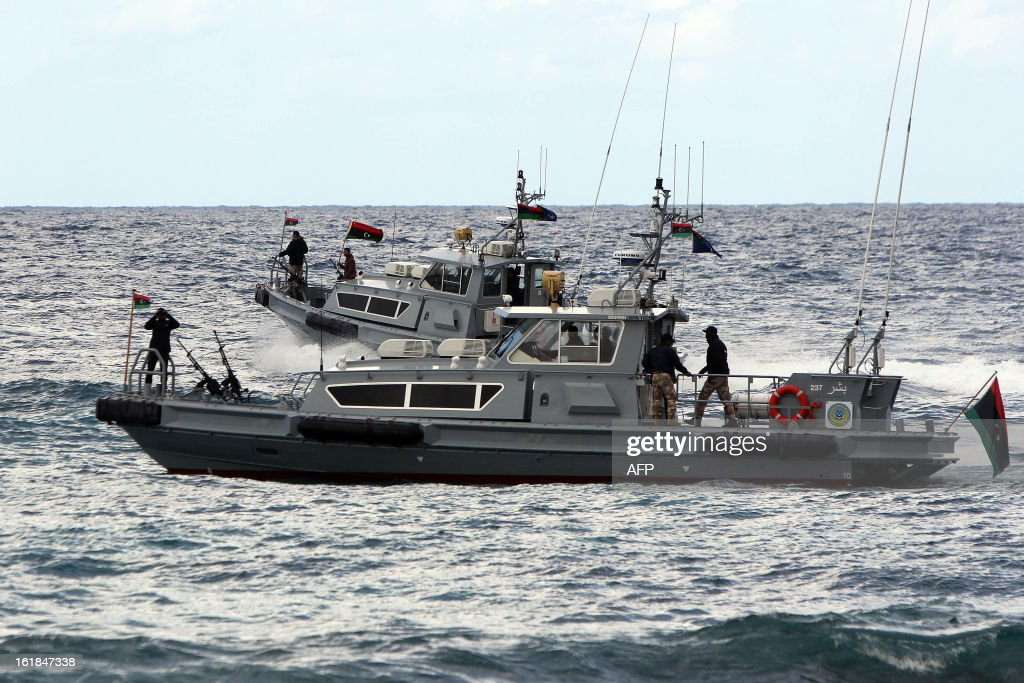 Libyan navy personnel patrol off the coast of the eastern city of Benghazi during a ceremony marking the second anniversary of the start of the Libyan revolution at Tahrir Square on February 17, 2013. Security forces were on high alert across Libya as the north African nation marked two years since the start of the revolt that toppled Moamer Kadhafi after four decades of iron rule.