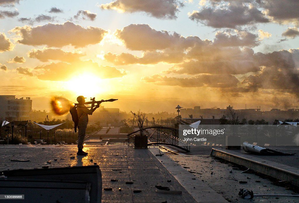 A Libyan NTC fighter fires his rocket-propelled grenade toward buildings in District Two of Colonel Gaddafi's home city of Sirte on October 11, 2011 in Libya. NTC forces are continuing their advance on Colonel Muammar Gaddafi's hometown of Sirte..