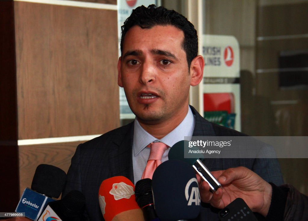 Libyan Parliament spokesman Omar Humaidan speaks to the media in Tripoli on March 11 2014 Earlier Tuesday Libya's interim parliament voted to...
