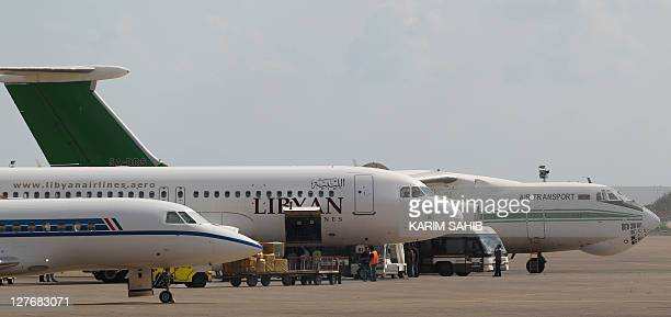 Libyan passenger aircrafts sit on the tarmac of Tripoli's Mitiga airport as internal flights between the Libyan capital and the eastern port city of...