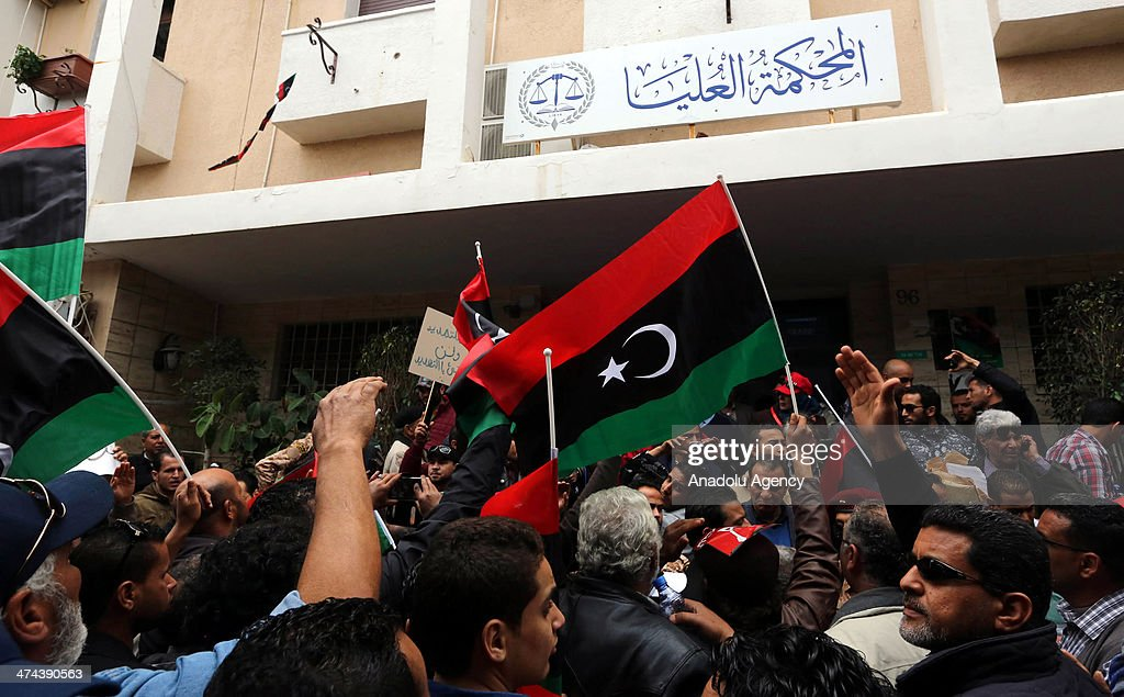 Libyan people protest against the extended mandate of the General National Congress in Tripoli Libya on February 23 2014 The GNC was elected in July...