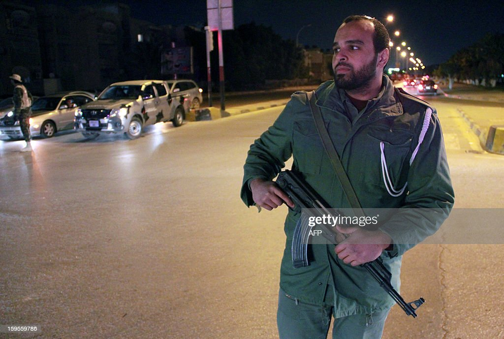 A Libyan policeman secures the area following of an explosion which killed police Sergeant Salah Miftah Wizry late on January 15, 2013 in the eastern Libyan city of Benghazi. The number of attacks targeting military and police officers, including ones who served the former regime, has increased in past weeks despite efforts by the new authorities to boost security in the Mediterranean city.