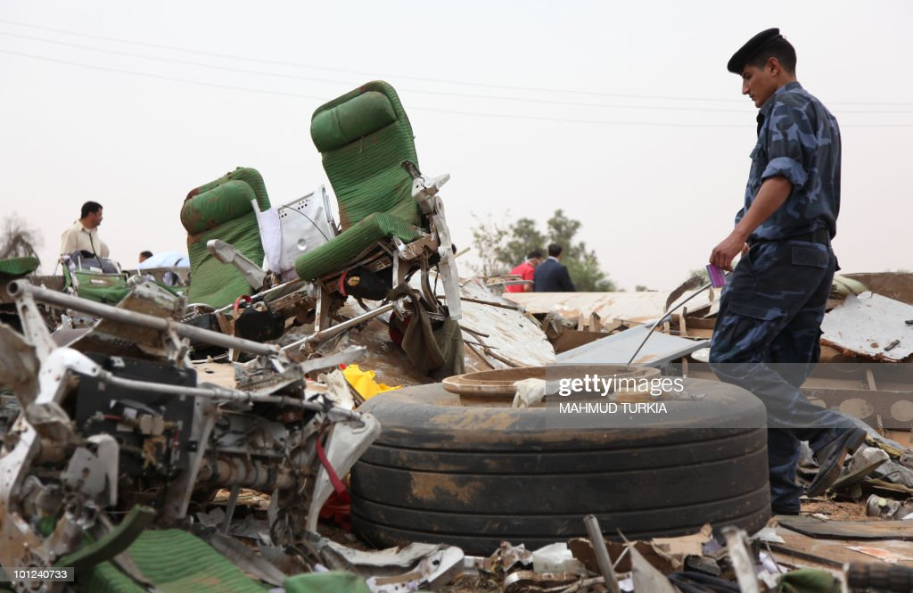 A Libyan policeman walks amid the debris of an Afriqiyah Airways passenger plane which crashed during landing at Tripoli airport on May 12, 2010. An eight-year-old Dutch boy was the sole survivor when a Libyan plane arriving from South Africa exploded on landing at the Libyan capital's airport, killing more than 100 people, officials said. There was no immediate indication of the cause of the crash, which occurred as the Afriqiyah Airways Airbus A330 plane was landing after a flight from Johannesburg at around 6 am (0400 GMT). The Libyan airline listed 93 passengers and 11 crew members on board its flight 8U771.