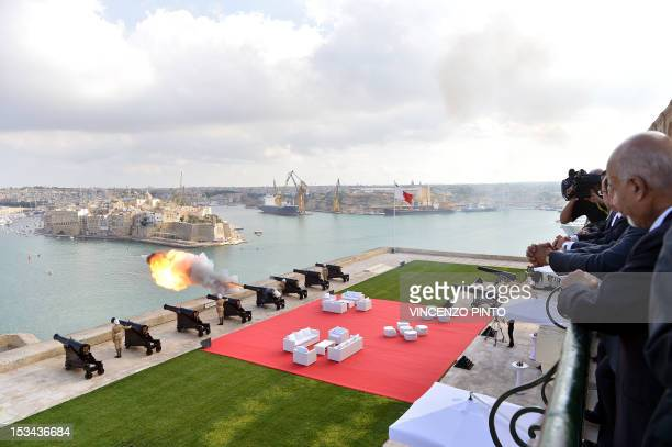 Libyan President Mohamed Magariaf and counterparts look at the Valletta harbor prior to posing for the photo family at the Upper Barracca Gardens in...