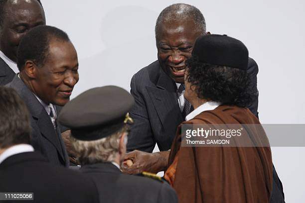 Libyan president Mouammar Kadhafi with Burkina Faso president Blaise Campaore and Ivory Coast president Laurent Gbagbo in Lisbon Portugal on December...