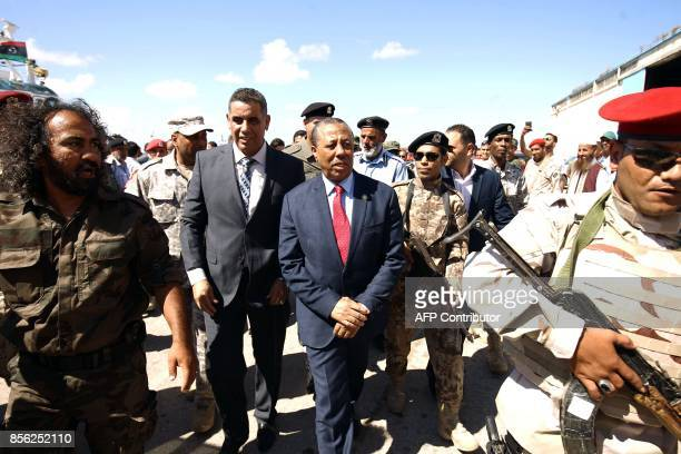 Libyan Prime Minister Abdullah alThani arrives at the Benghazi port which was closed for the past three years due to rebel groups occupying the...