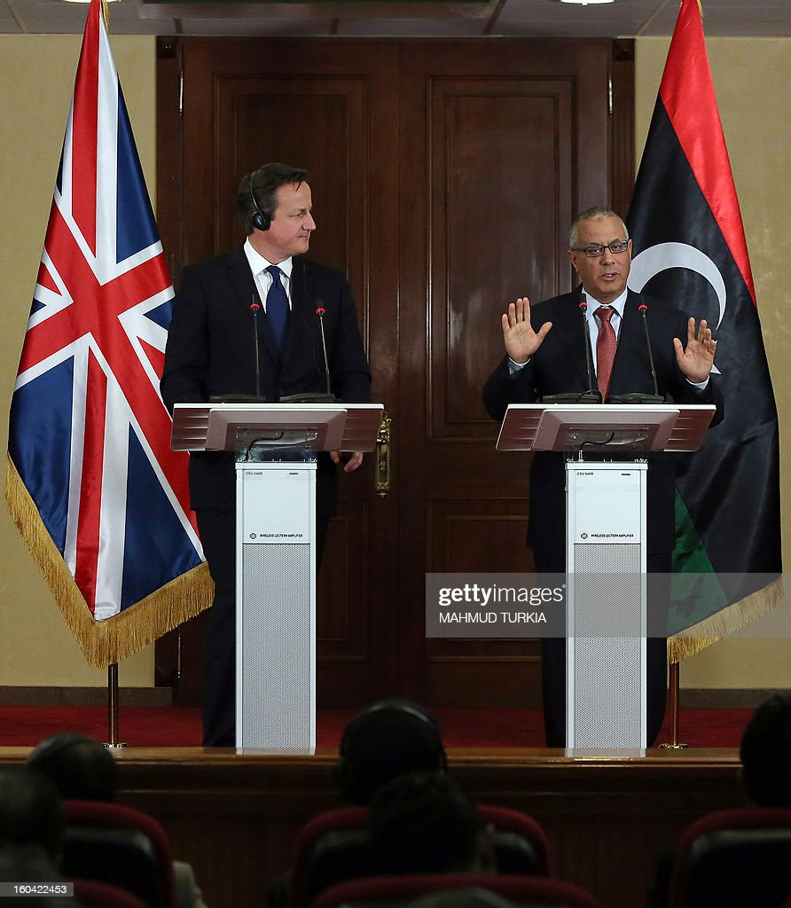 Libyan prime minister Ali Zaidan (R) and British Prime Minister David Cameron (L) speak during a press conference after their meeting in Tripoli on January 31, 2013. Cameron does a surprise visit in Libya following a one-day-visit in Algeria in the wake of this month's hostage crisis in the Sahara in which several Britons were killed.